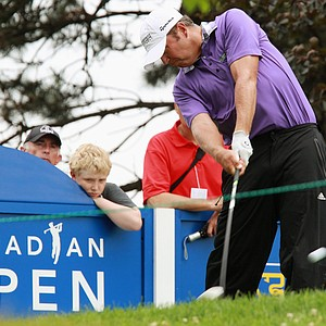 Bo Van Pelt hits a tee shot on the 17th hole during the first round of the Canadian Open golf tournament, Thursday, July 26, 2012, in Ancaster, Ontario.