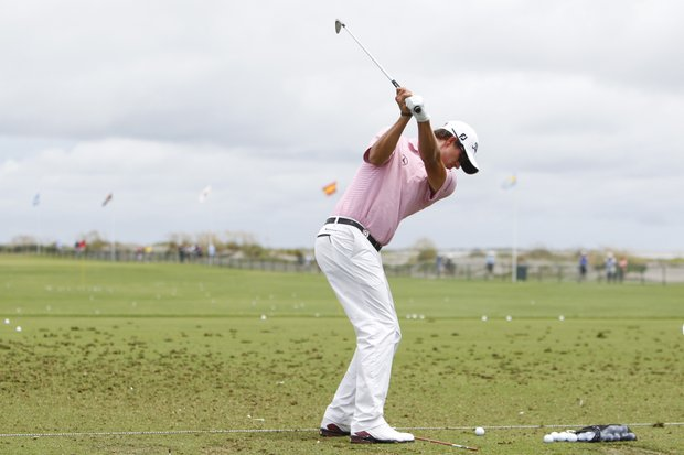 Adam Scott of Australia warms up on the driving range during a practice round for the PGA Championship golf tournament on the Ocean Course of the Kiawah Island Golf Resort in Kiawah Island, S.C., Wednesday, Aug. 8, 2012.