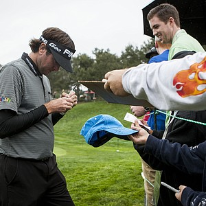 Bubba Watson signs autographs after the Pro-Am round of the World Challenge golf tournament, an unofficial PGA Tour event sponsored by pro golfer Tiger Woods, at Sherwood Country Club in Thousand Oaks, Calif., Wednesday, Nov. 28, 2012. Proceeds will benefit the Tiger Woods Foundation. (