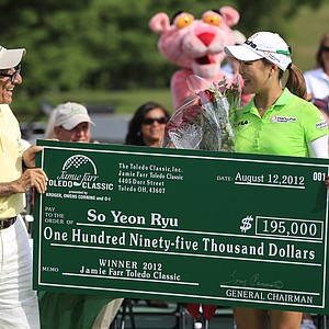 So Yeon Ryu of South Korea receives the check from Jamie Farr after winning the Jamie Farr Toledo Classic at Highland Meadows Golf Club in Sylvania, Ohio, Sunday, Aug. 12, 2012. Ryu rode a string of six straight birdies in the middle of her round to a 9-under 62 and a seven-stroke victory.