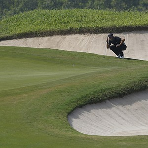 Martin Kaymer from Germany lines a putt on the 5th green during the third round of the HSBC Champions golf tournament in Dongguan, southern China's Guangdong province, Saturday, Nov. 3, 2012.
