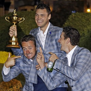 Europe's Martin Kaymer, Graeme McDowell and Justin Rose have some fun after winning the Ryder Cup PGA golf tournament Sunday, Sept. 30, 2012, at the Medinah Country Club in Medinah, Ill.