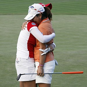 Mika Miyazato, from Okinawa, Japan, right, is hugged by fellow golfer So Yeon Ryu, from South Korea, after winning the final round of the LPGA Safeway Classic golf tournament in North Plains, Ore., Sunday, Aug. 19, 2012. Miyazato won her first LPGA tournament with a score of 13-under-par 203.