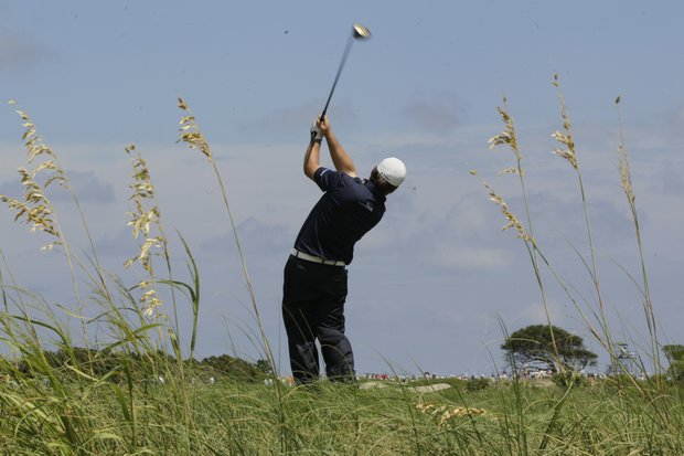 Graeme McDowell, of Northern Ireland, hits from the fourth tee during the first round of the PGA Championship golf tournament on the Ocean Course of the Kiawah Island Golf Resort in Kiawah Island, S.C., Thursday, Aug. 9, 2012.
