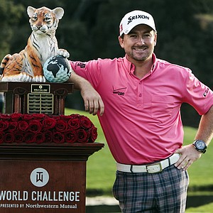 Graeme McDowell poses with the trophy after winning the World Challenge golf tournament at Sherwood Country Club in Thousand Oaks, Calif., Sunday, Dec. 2, 2012.