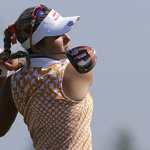 Lexi Thompson watches her drive from the 18th tee during second round play in the Navistar LPGA Classic golf tournament, Friday, Sept. 21, 2012, at the Robert Trent Jones Golf Trail in Prattville, Ala.