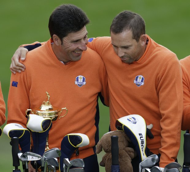 European team captain Jose Maria Olazabal talks to Sergio Garcia during the Ryder Cup PGA golf tournament Tuesday, Sept. 25, 2012, at the Medinah Country Club in Medinah, Ill.