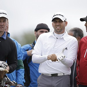 Sergio Garcia of Spain, center, talks to his team on the 4th tee during a practice round at Royal Lytham & St Annes golf club ahead of the British Open Golf Championship, Lytham St Annes, England, Wednesday, July 18, 2012.