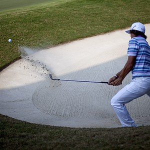 Rickie Fowler hits out of the sand trap on the 16th hole during the third round of the Tour Championship golf tournament Saturday, Sept. 22, 2012, in Atlanta.