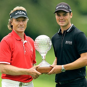 German golfer Bernhard Langer, left, with fellow country man Martin Kaymer, right, holds a trophy after winning the final round of the Nedbank Champions Challenge seniors event at the Gary Player Country Club in Sun City, South Africa, Saturday, Dec. 1, 2012. Kaymer, holds a one-stroke lead on Saturday, heading into the final round of the Nedbank Golf Challenge.