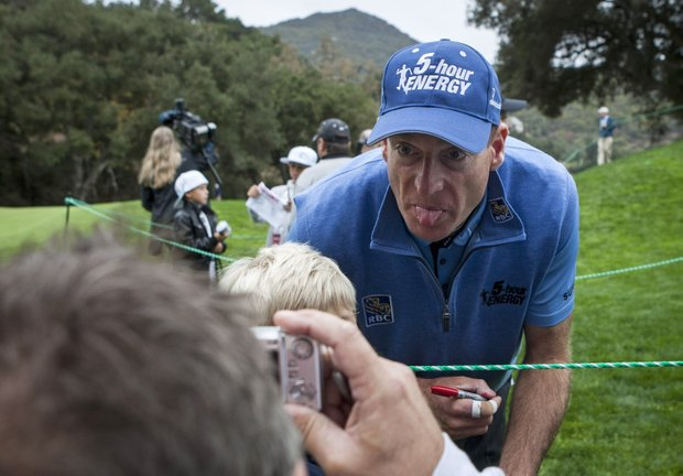 Jim Furyk sticks his tongue out while posing for a photo after the Pro-Am round of the World Challenge golf tournament, an unofficial PGA Tour event sponsored by pro golfer Tiger Woods, at Sherwood Country Club in Thousand Oaks, Calif., Wednesday, Nov. 28, 2012. Proceeds will benefit the Tiger Woods Foundation.