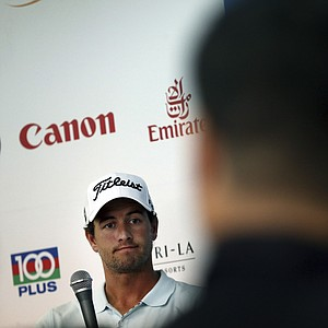 Australian golfer Adam Scott attends a press conference on Tuesday, Nov. 6, 2012, in Singapore ahead of the Barclays Singapore Open golf tournament which starts Thursday.