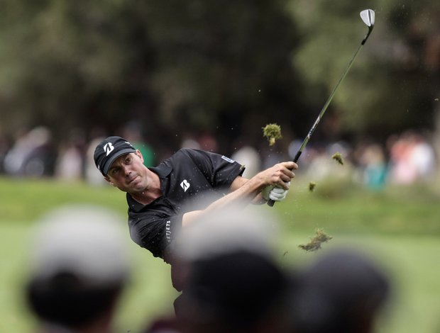Matt Kuchar hits a shot on the 16th hole during the third round of the World Challenge golf tournament at Sherwood Country Club in Thousand Oaks, Calif., Saturday, Dec. 1, 2012.
