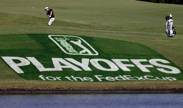 John Huh takes a shot on the practice green at the Tour Championship golf tournament Wednesday, Sept. 19, 2012, in Atlanta.
