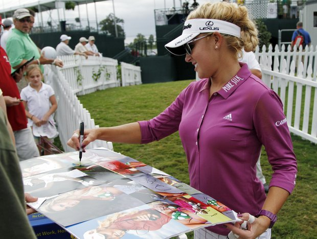 Natalie Gulbis signs autographs after the first round of the Kingsmill Championship LPGA Tour golf tournament in Williamsburg, Va., Thursday, Sept. 6, 2012.