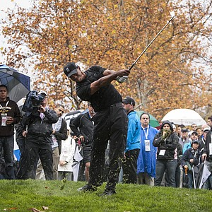 Tiger Woods hits out of the rough on the fifth hole during the third round of the World Challenge golf tournament at Sherwood Country Club in Thousand Oaks, Calif., Saturday, Dec. 1, 2012.