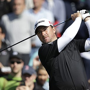 Graeme McDowell of Northern Ireland plays a shot off the 18th tee during a practice round at Royal Lytham & St Annes golf club ahead of the British Open Golf Championship, Lytham St Annes, England, Wednesday, July 18, 2012.