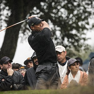 Tiger Woods tees off on the second hole during the third round of the World Challenge golf tournament at Sherwood Country Club in Thousand Oaks, Calif., Saturday, Dec. 1, 2012.