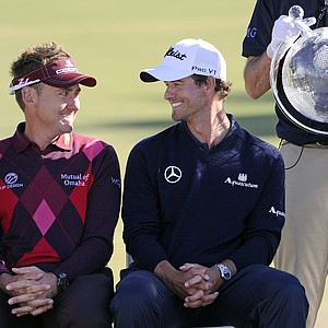 Ian Poulter, left, of England and Adam Scott from Australia chat on the 18th green during the trophy presentation after the final round of the Australian Masters golf tournament at Kingston Heath Golf Club, in Melbourne, Australia, on Sunday, Nov. 18, 2012. Scott had five front-nine birdies Sunday and another on 18 for a 5-under-par 67 and a four-stroke win over Poulter in his first victory of the year.