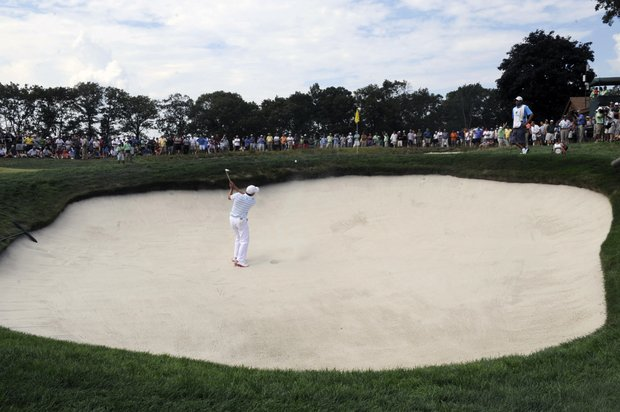 Sergio Garcia, of Spain, hits out of a bunker on the fourth of the third round of The Barclays golf tournament at Bethpage State Park in Farmingdale, N.Y., Saturday, Aug. 25, 2012.