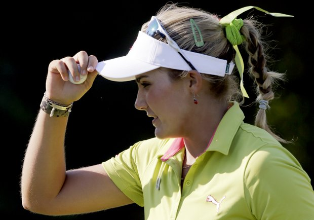 Lexi Thompson tips her cap after making a birdie on the 17th green during the first round of the Navistar LPGA Classic golf tournament, Thursday, Sept. 20, 2012, at the Robert Trent Jones Golf Trail in Prattville, Ala.