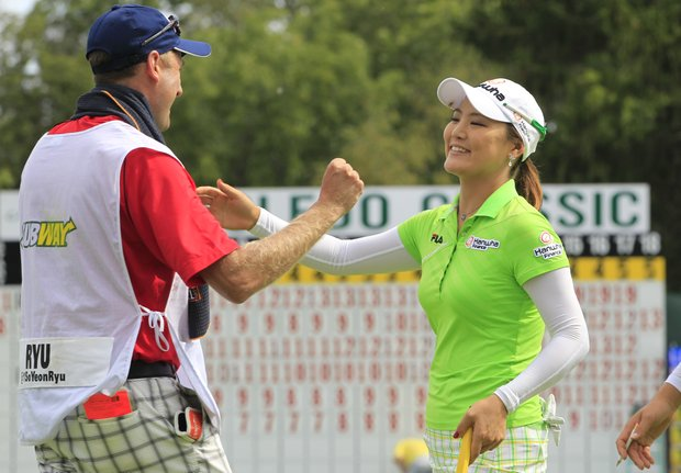 So Yeon Ryu of South Korea hugs her caddie Tom Watson after winning the Jamie Farr Toledo Classic at Highland Meadows Golf Club in Sylvania, Ohio, Sunday, Aug. 12, 2012. Ryu rode a string of six straight birdies in the middle of her round to a 9-under 62 and a seven-stroke victory.