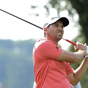 Sergio Garcia, of Spain, watches his drive on the second hole during the second round of The Barclays golf tournament at Bethpage State Park in Farmingdale, N.Y., Friday, Aug. 24, 2012.