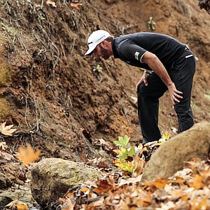 ustin Johnson looks for his ball in a creek on the fifth hole during the final round of the World Challenge golf tournament at Sherwood Country Club in Thousand Oaks, Calif., Saturday, Dec. 2, 2012.