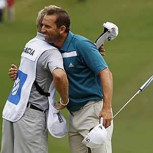 Sergio Garcia hugs his caddie after winning the rain delayed Wyndham Championship golf tournament in Greensboro, N.C., Monday, Aug. 20, 2012.