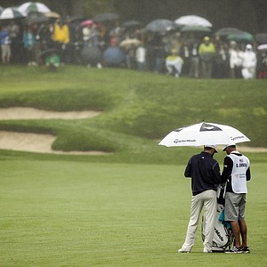 Dustin Johnson waits to hit on the fifth hole during the third round of the World Challenge golf tournament at Sherwood Country Club in Thousand Oaks, Calif., Saturday, Dec. 1, 2012.