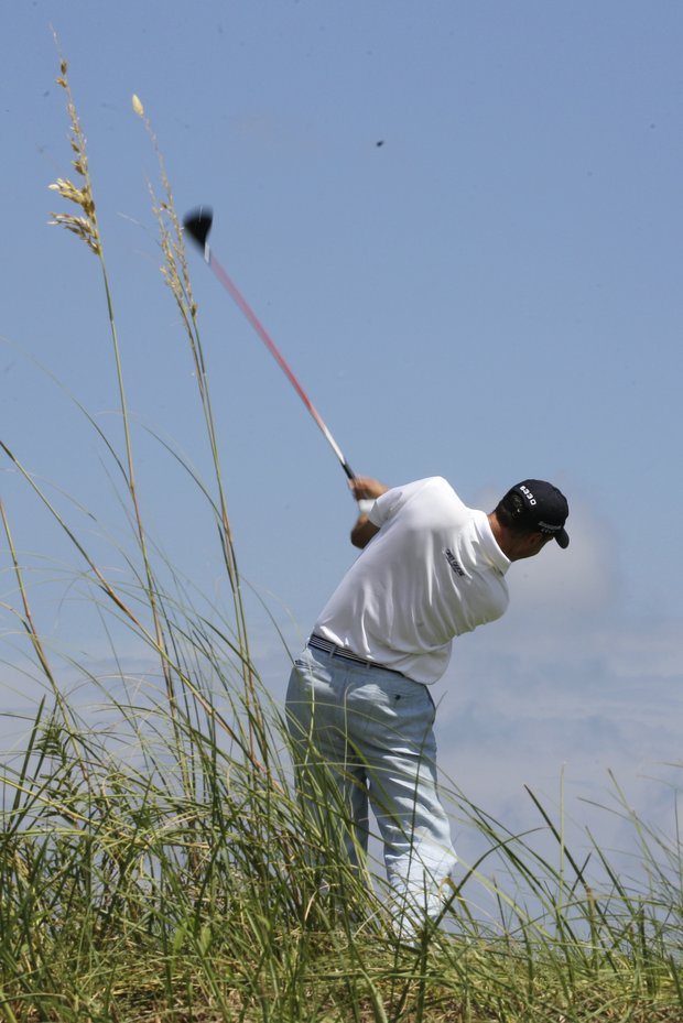 Matt Kuchar hits from the fourth tee during the first round of the PGA Championship golf tournament on the Ocean Course of the Kiawah Island Golf Resort in Kiawah Island, S.C., Thursday, Aug. 9, 2012.