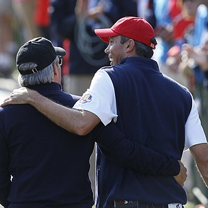Fred Couples, left, walks with USA's Matt Kuchar on the seventh hole during a four-ball match at the Ryder Cup PGA golf tournament Friday, Sept. 28, 2012, at the Medinah Country Club in Medinah, Ill.