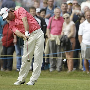 Graeme McDowell of Northern Ireland plays a shot on the third hole at Royal Lytham & St Annes golf club during the final round of the British Open Golf Championship, Lytham St Annes, England Sunday, July 22, 2012.