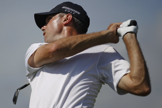 Matt Kuchar watches his drive from the eighth tee during the first round of the PGA Championship golf tournament on the Ocean Course of the Kiawah Island Golf Resort in Kiawah Island, S.C., Thursday, Aug. 9, 2012.
