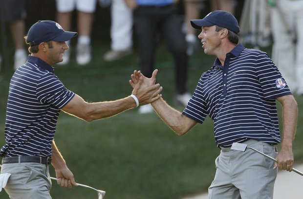 USA's Matt Kuchar, right, and Dustin Johnson celebrate after winning the 17th hole during a four-ball match at the Ryder Cup PGA golf tournament Saturday, Sept. 29, 2012, at the Medinah Country Club in Medinah, Ill.