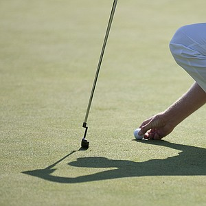 Adam Scott, from Australia, places his ball on the ninth green during the first round of the Deutsche Bank Championship PGA golf tournament at TPC Boston in Norton, Mass., Friday, Aug. 31, 2012.
