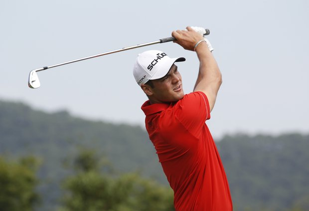 Martin Kaymer of Germany tees off at the 17th hole during the first round of the WGC-HSBC Champions golf tournament in Dongguan, southern China's Guangdong province, Thursday Nov. 1, 2012.