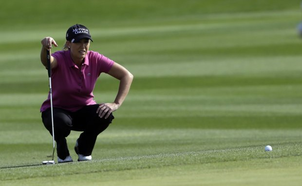 Cristie Kerr of the U.S. lines up a putt at the seventh hole during the first round of the LPGA Championship golf tournament at Sky72 Golf Club in Incheon, west of Seoul, South Korea, Friday, Oct. 19, 2012.