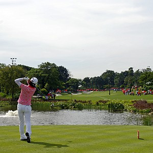 Na Yeon Choi of South Korea tees off on the 3rd hole during the final round of the LPGA Malaysia golf tournament at Kuala Lumpur Golf and Country Club in Kuala Lumpur, Malaysia, Sunday, Oct. 14, 2012.