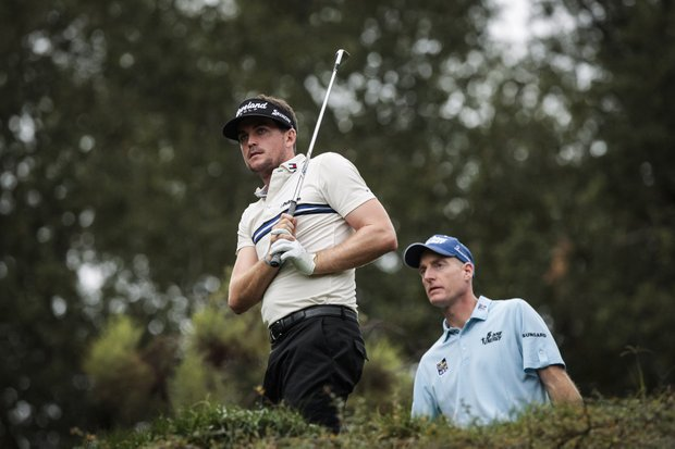 Keegan Bradley and Jim Furyk watch Bradley's tee shot on the 17th hole during the third round of the World Challenge golf tournament at Sherwood Country Club in Thousand Oaks, Calif., Saturday, Dec. 1, 2012.
