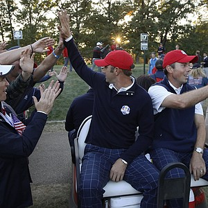 USA's Dustin Johnson and Matt Kuchar celebrate after winning a four-ball match at the Ryder Cup PGA golf tournament Friday, Sept. 28, 2012, at the Medinah Country Club in Medinah, Ill.
