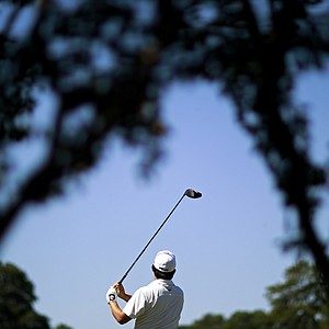 John Huh tees off on the seventh hole during the final round of the Tour Championship golf tournament, Sunday, Sept. 23, 2012, in Atlanta.