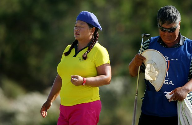 Christina Kim leaves the 17th green with her father/caddie Man Kim during the final round of LPGA Q-School. Kim failed to keep her tour card.
