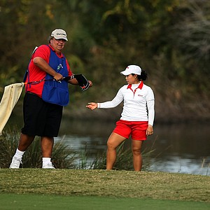 Moriya Jutanugarn with her caddie Eric Bajas at No. 18 during the final round of LPGA Q-School.