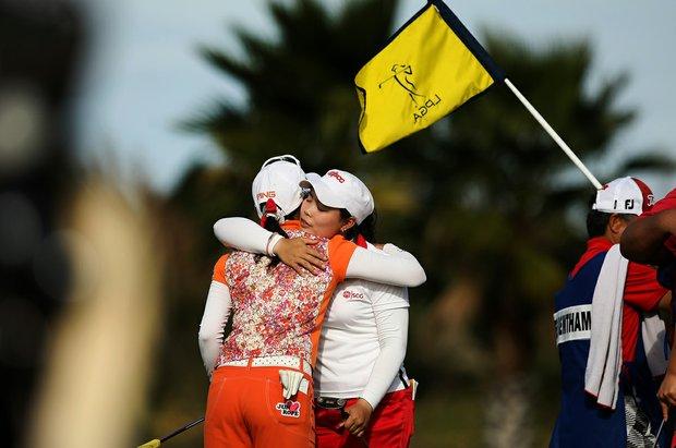 Moriya Jutanugarn of Thailand hugs Japan's Ayako Uehara after the final round of LPGA Q-School.