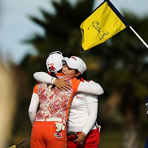 Moriya Jutanugarn of Thailand hugs Japan's Ayako Uehara after the final round of LPGA Q-School. Both players earned their tour cards.