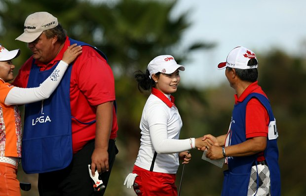 Moriya Jutanugarn, center, of Thailand tied with Rebecca Lee-Bentham of Canada for the lead during the final round of LPGA Q-School.