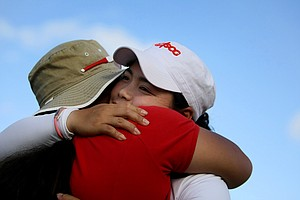 Moriya Jutanugarn gets a hug from her mom after the final round of LPGA Q-School.