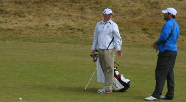 Matt Mahanic (left), the former Huntingdon College coach, caddies for former player Chase Blaich at the 2010 U.S. Amateur at Chambers Bay.