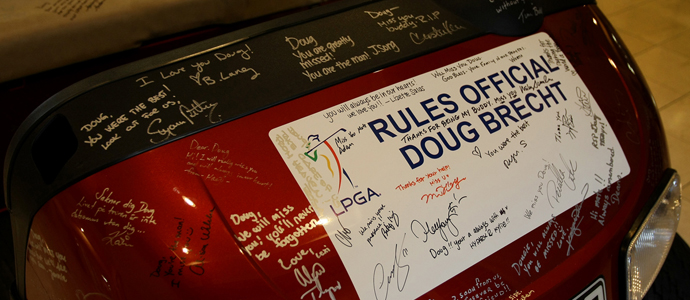 A golf cart signed by many sits in the lobby of LPGA headquarters in memorial of rules official Doug Brecht at LPGA International. Brecht was a longtime rules official that passed away recently due to complications from meningitis associated with the West Nile Virus.